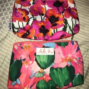 2 Clinique floral cosmetic bags/travel bags